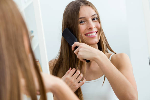 Woman Brushing Her Long Brunette Hair